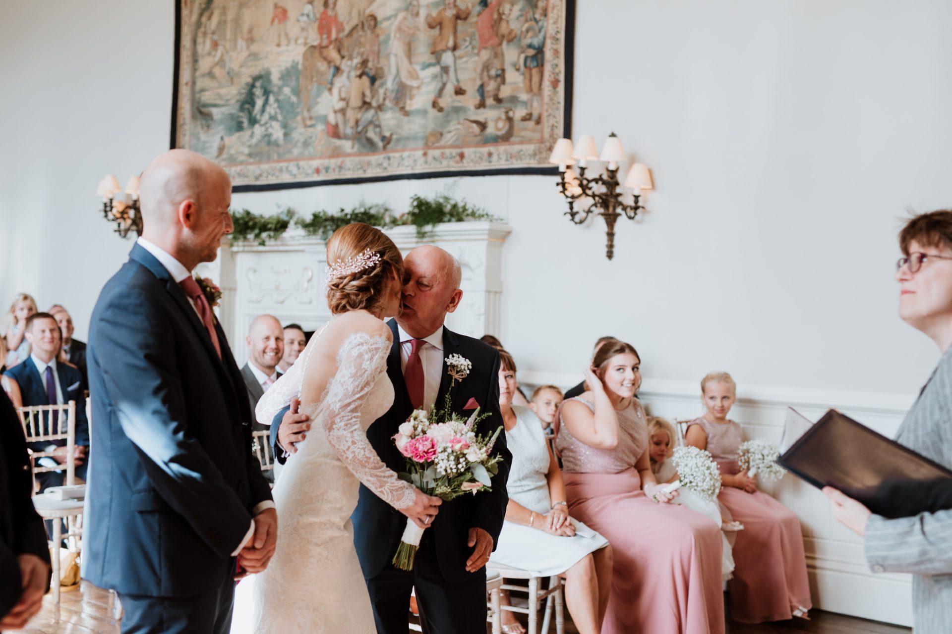 bride kisses her father wedding ceremony
