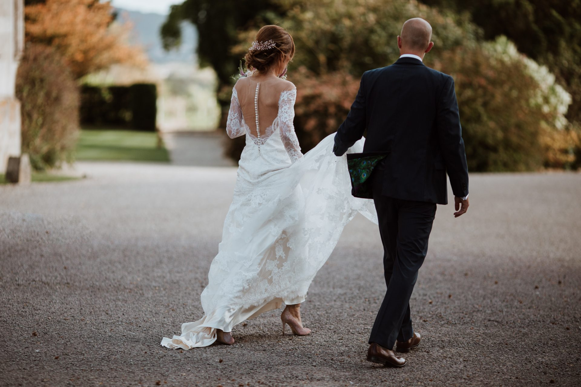 bride and groom walk away from camera