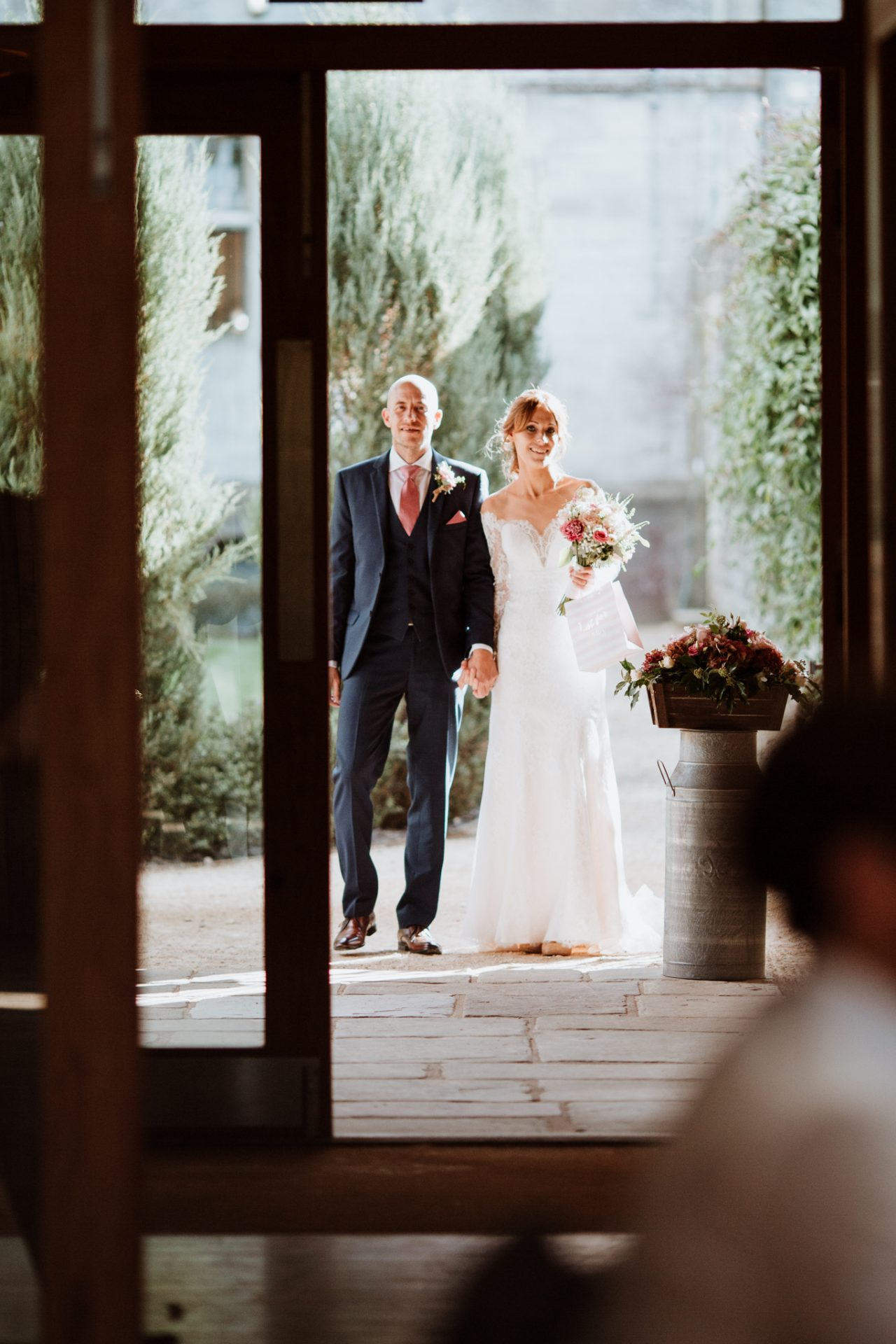 bride and groom wait outside for their entrance