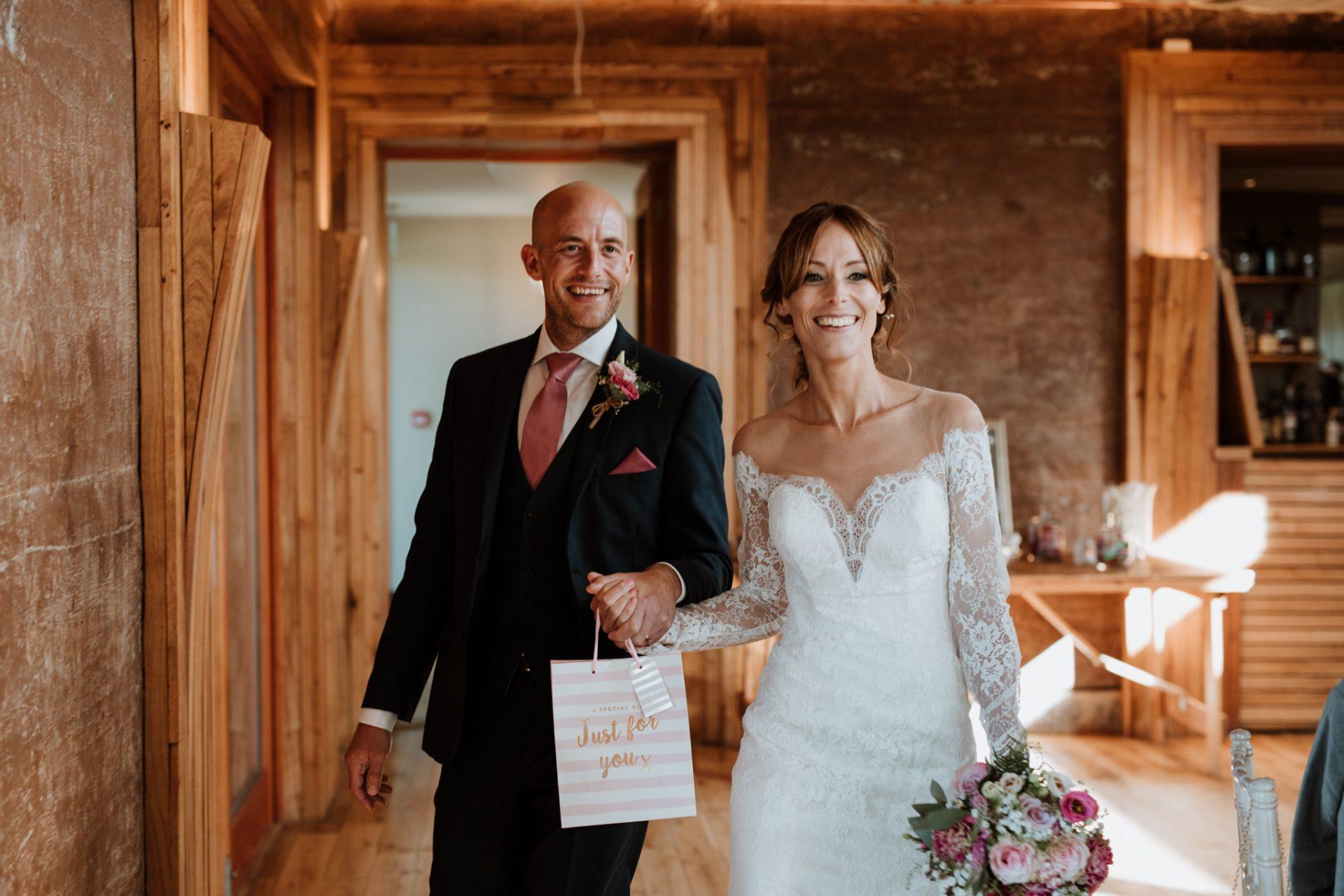 couple walk in to wedding breakfast room