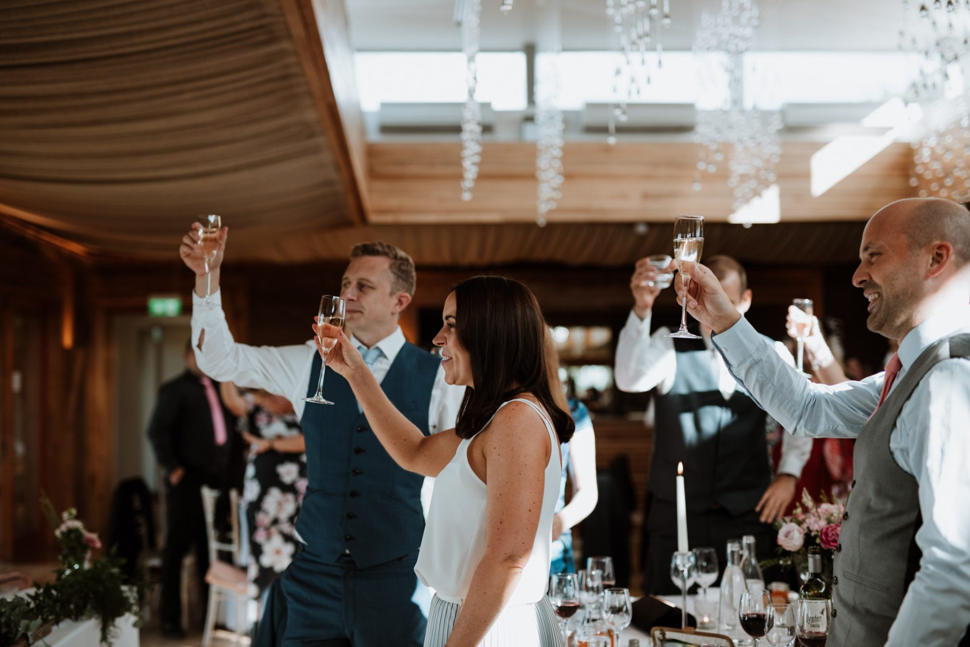 guests raise their glasses