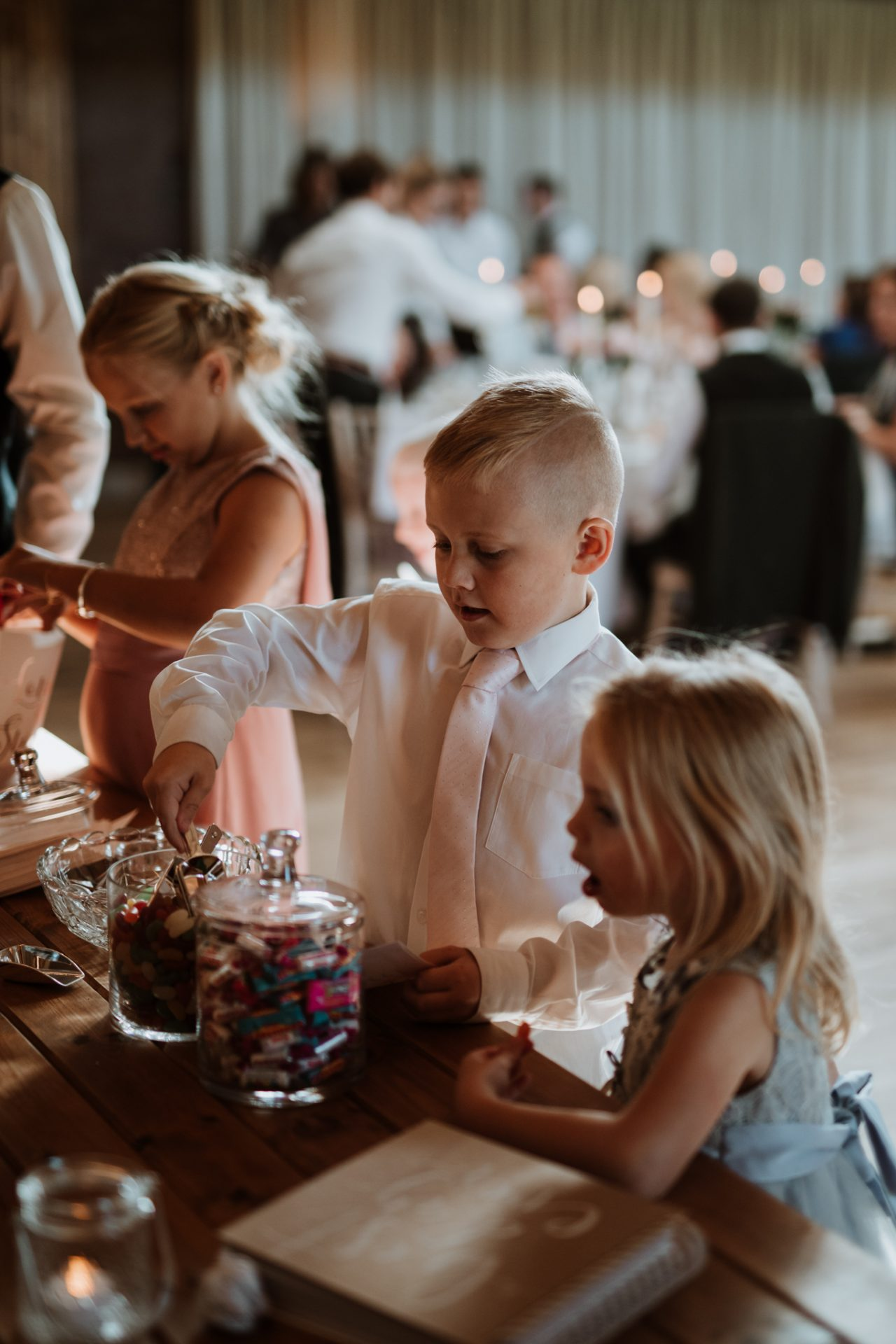 children help themselves to sweet table