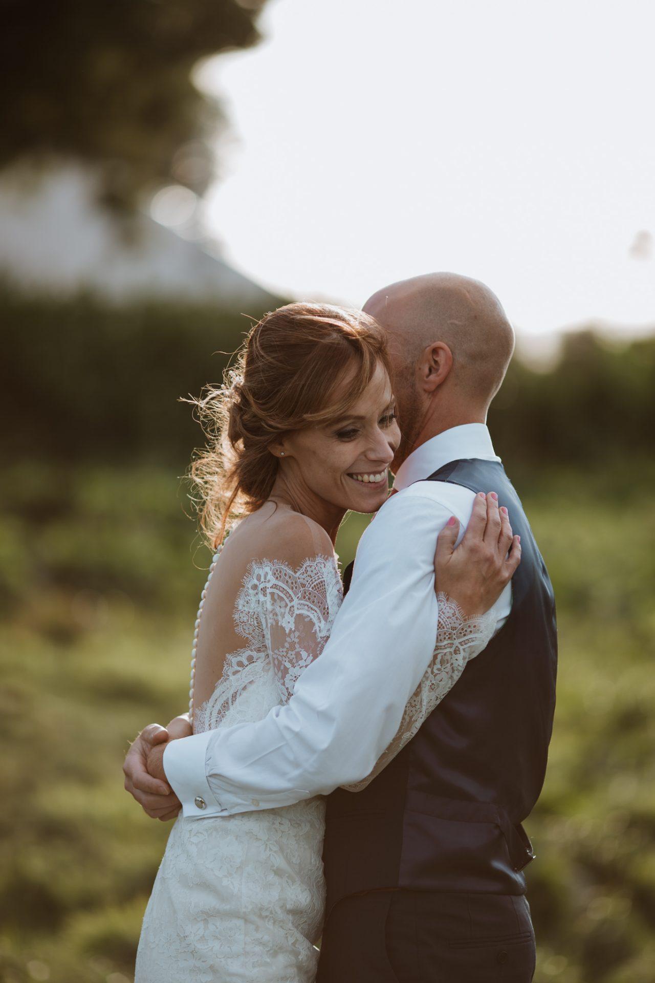 golden hour bride and groom hug