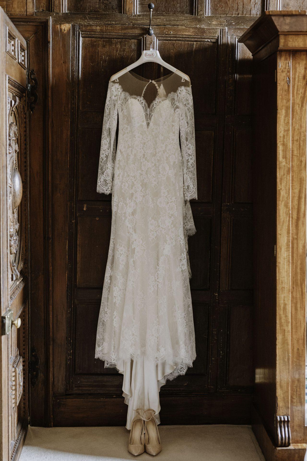 lace wedding dress hanging up