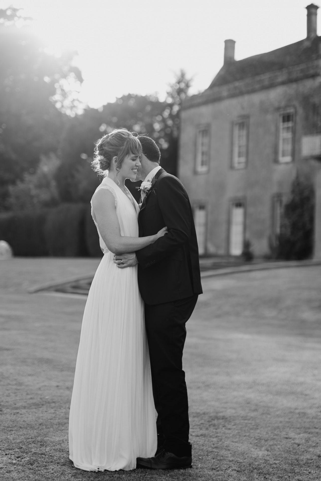 bride and groom hug north cadbury court golden hour