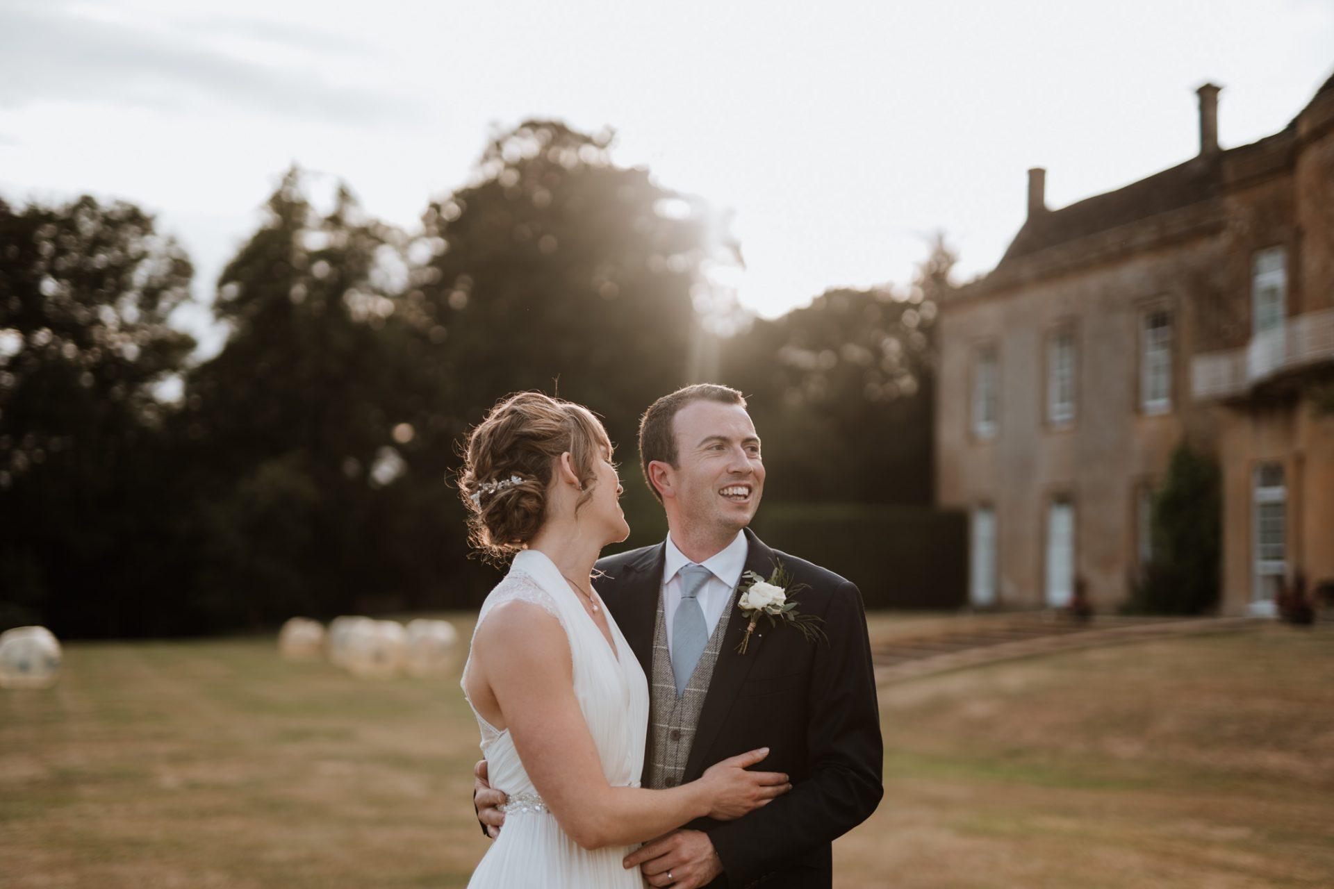 bride and groom laugh north cadbury court golden hour