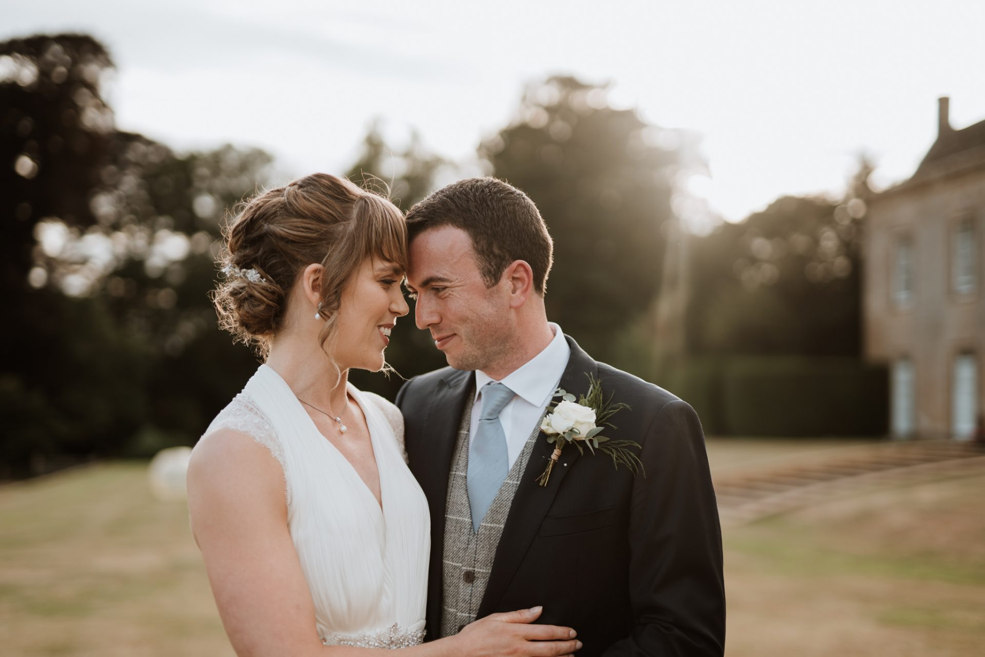 bride and groom touch foreheads north cadbury court golden hour
