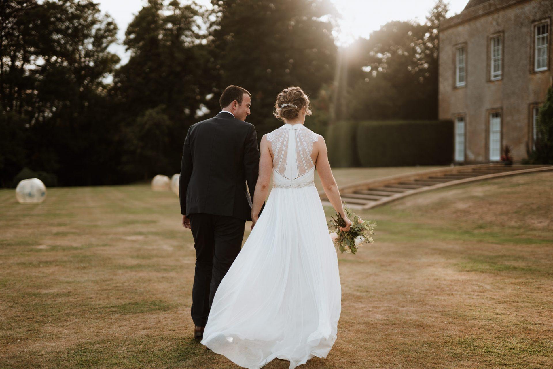bride and groom walk away north cadbury court golden hour