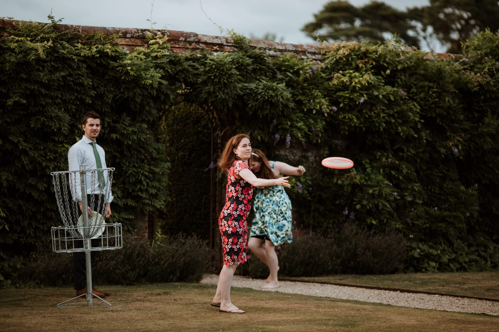 wedding guest playing frisbee