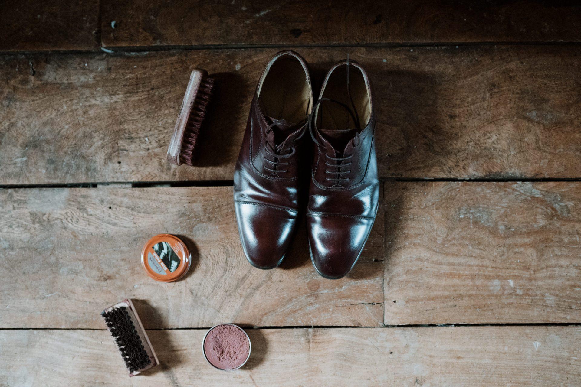 groom shining shoes morning prep