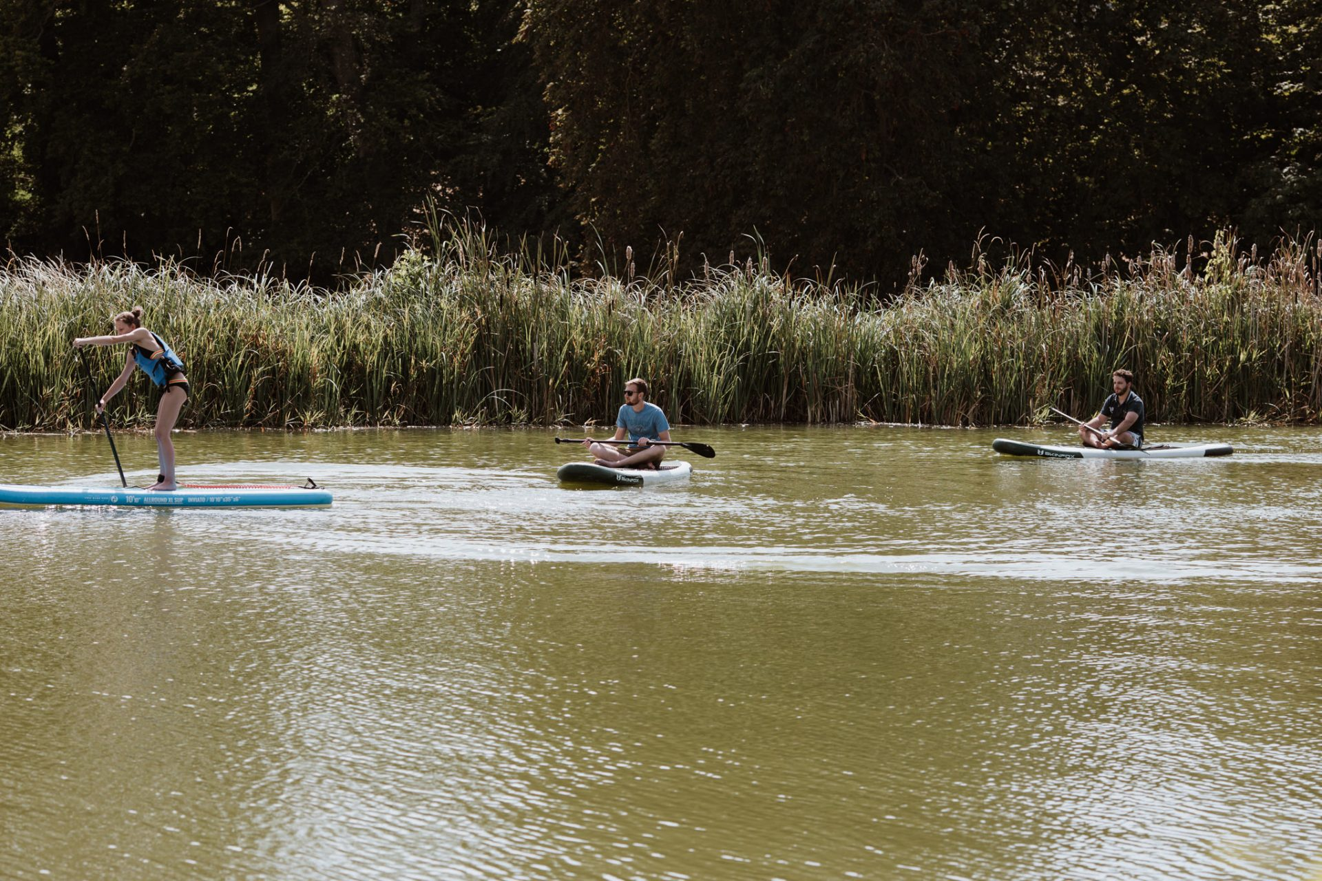 guests paddle boarding on the lake