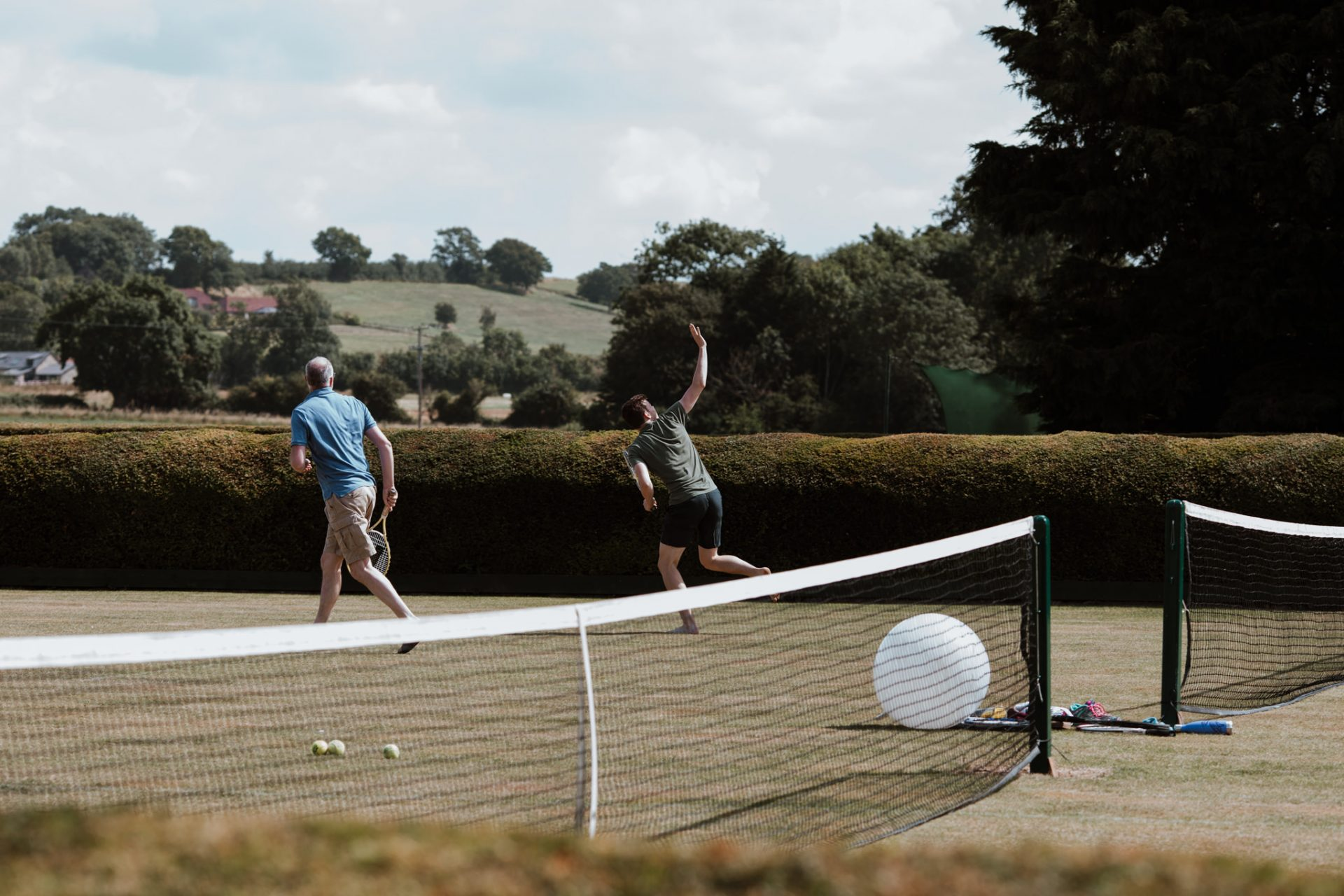 guests playing tennis