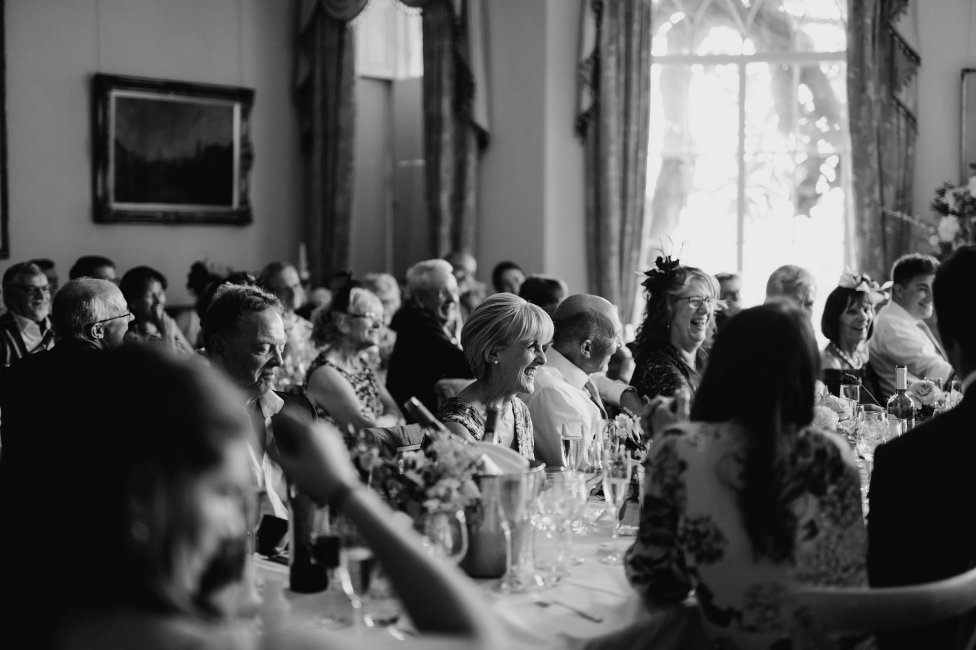 wedding breakfast guests laughing speeches candid