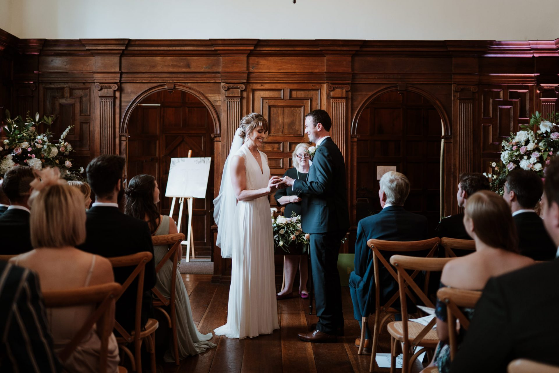 bride and groom exchange rings during the cermeony