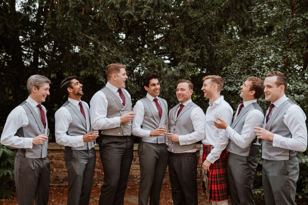groomsmen and groom relaxed group photo