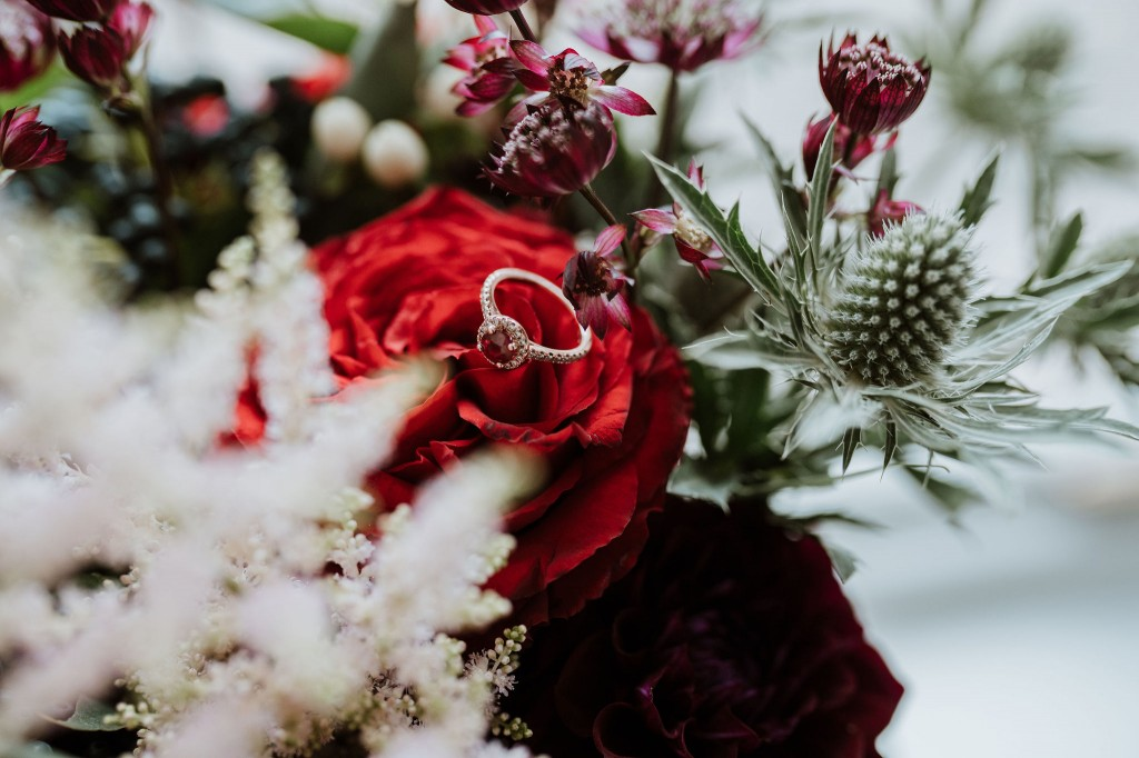 ruby engagement ring red winter wedding flowers