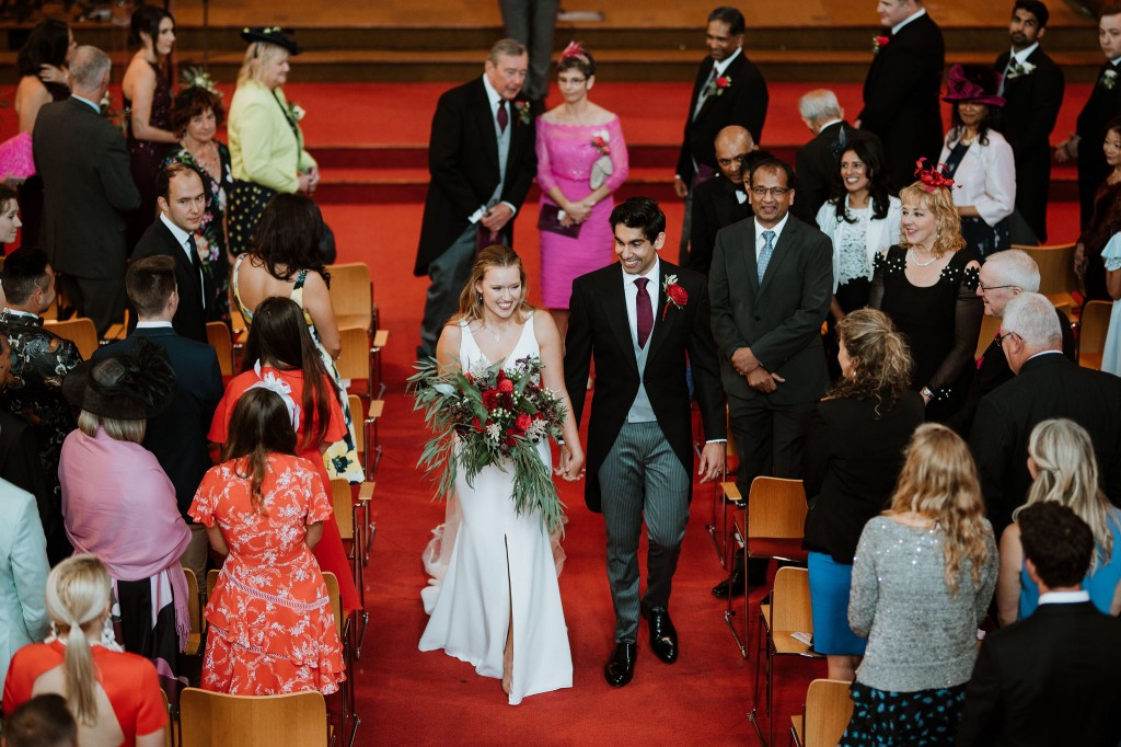 bride and groom leaving church balcony shot