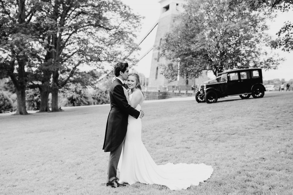bride groom forehead kiss, couples wedding photo, clifton suspension bridge, vintage wedding car