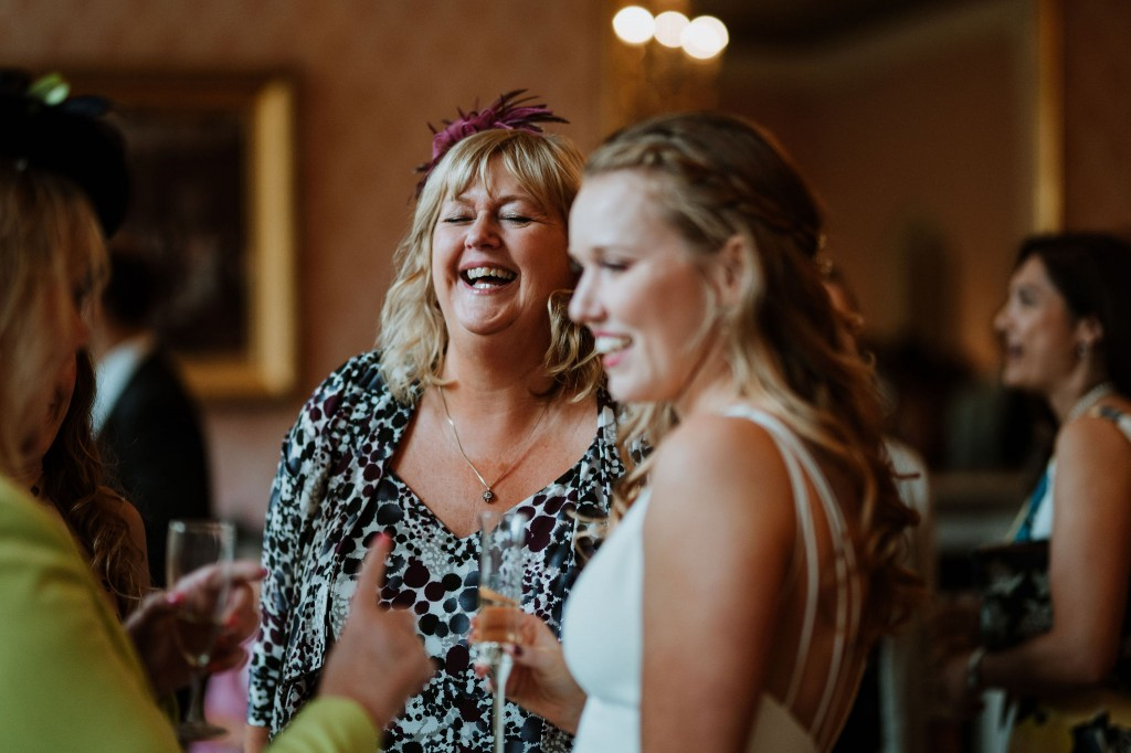 candid wedding photos guests laughing clifton club