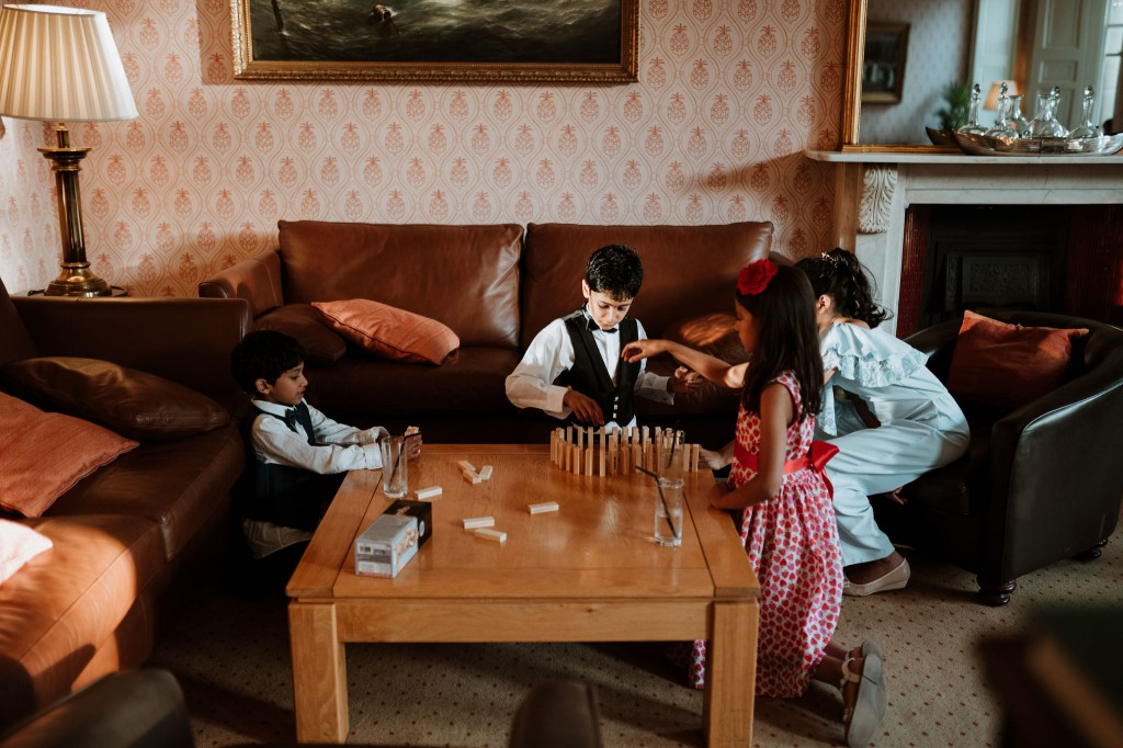 children guests playing chess
