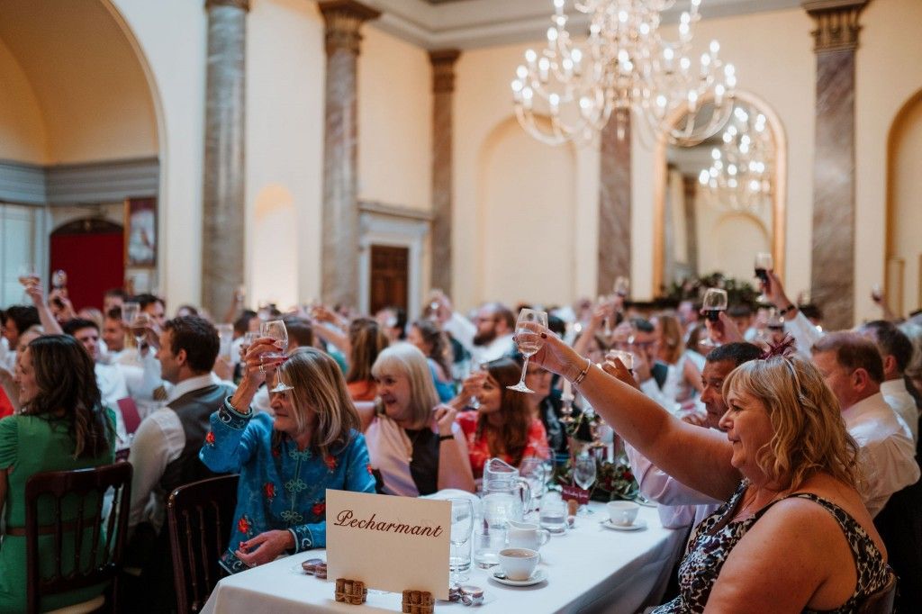 guests toasting during wedding speeches