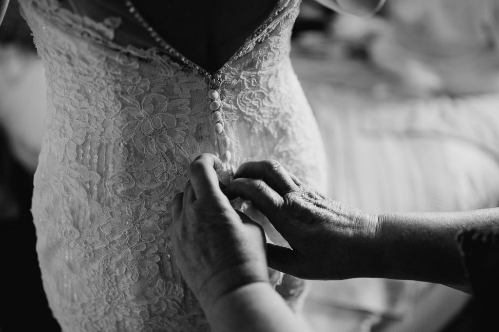bride putting on her enzoani wedding dress