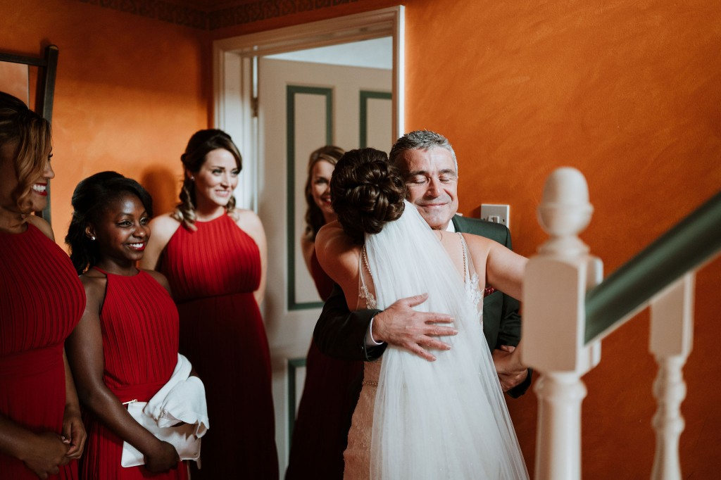 father hugging the bride