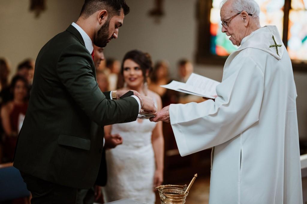 best man handing over the wedding rings