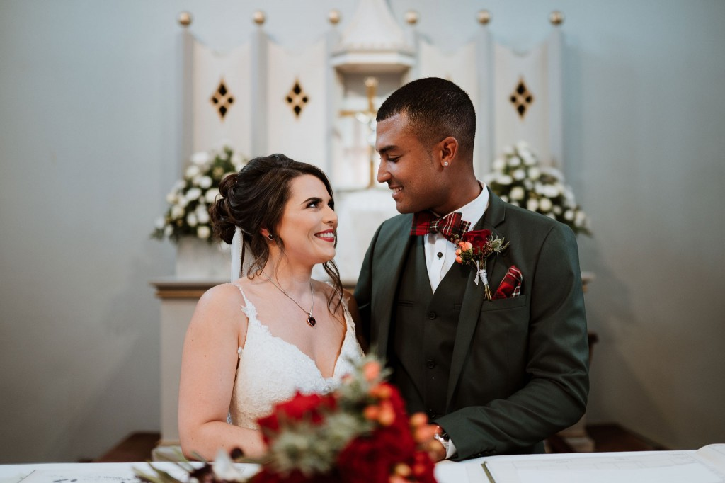 bride and groom signing the register in church chippenham