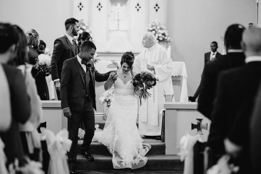 bride and groom walking down the aisle st marys church chippenham