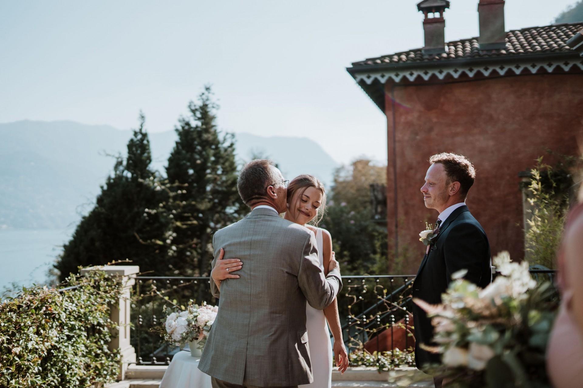father and bride hug