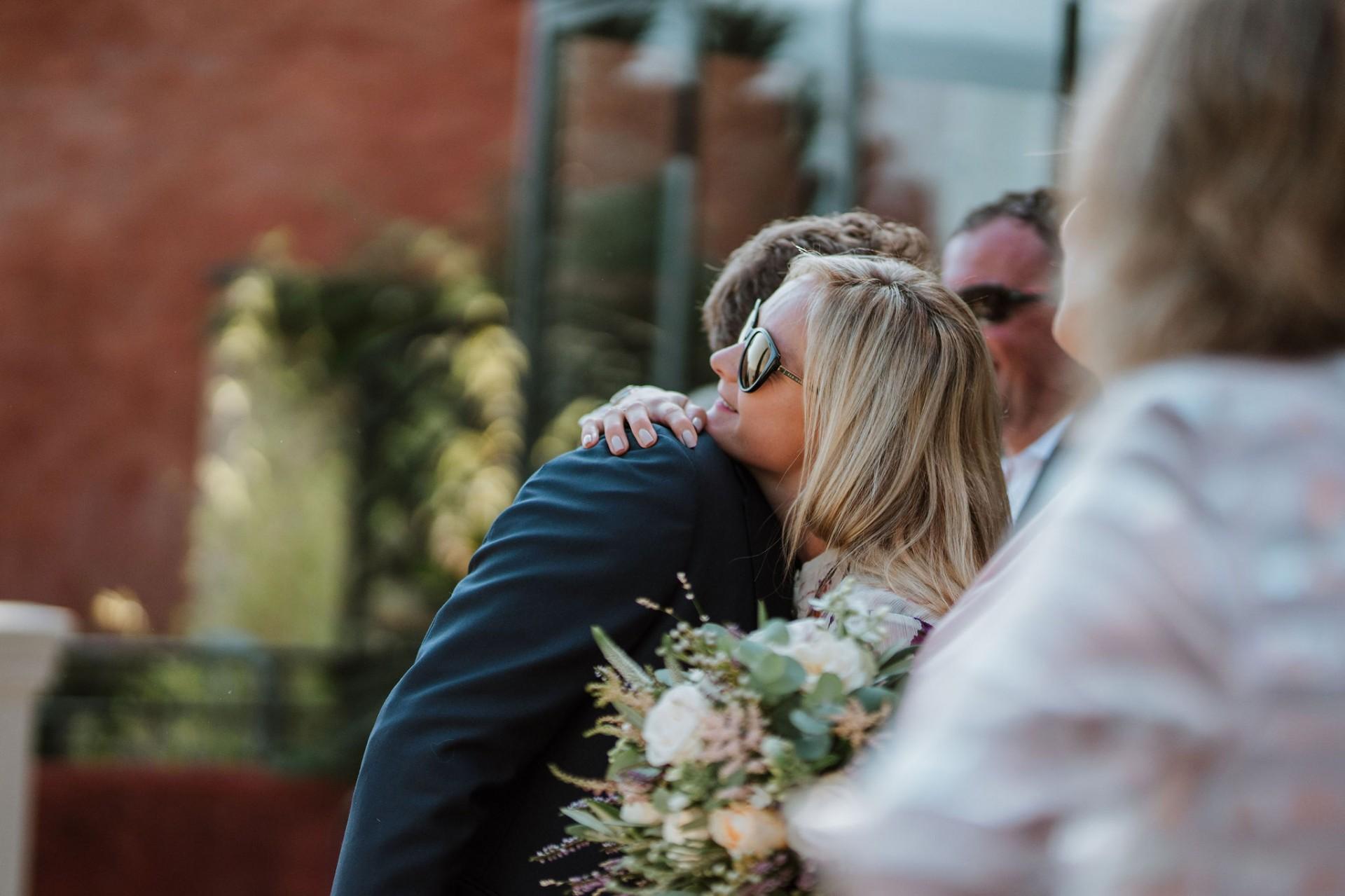 groom sister hug