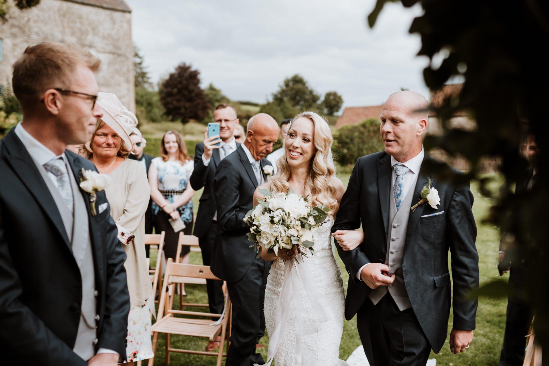 bride seeing groom at the altar