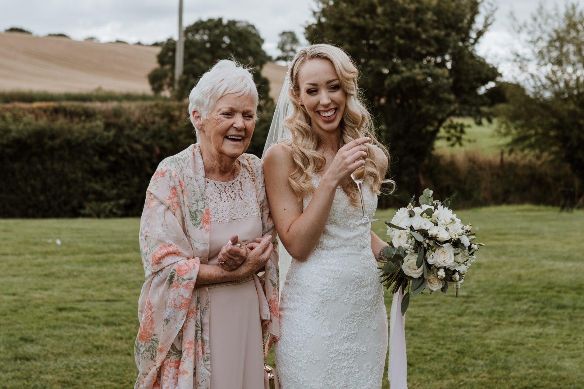 bride & grandma laughing natural photo