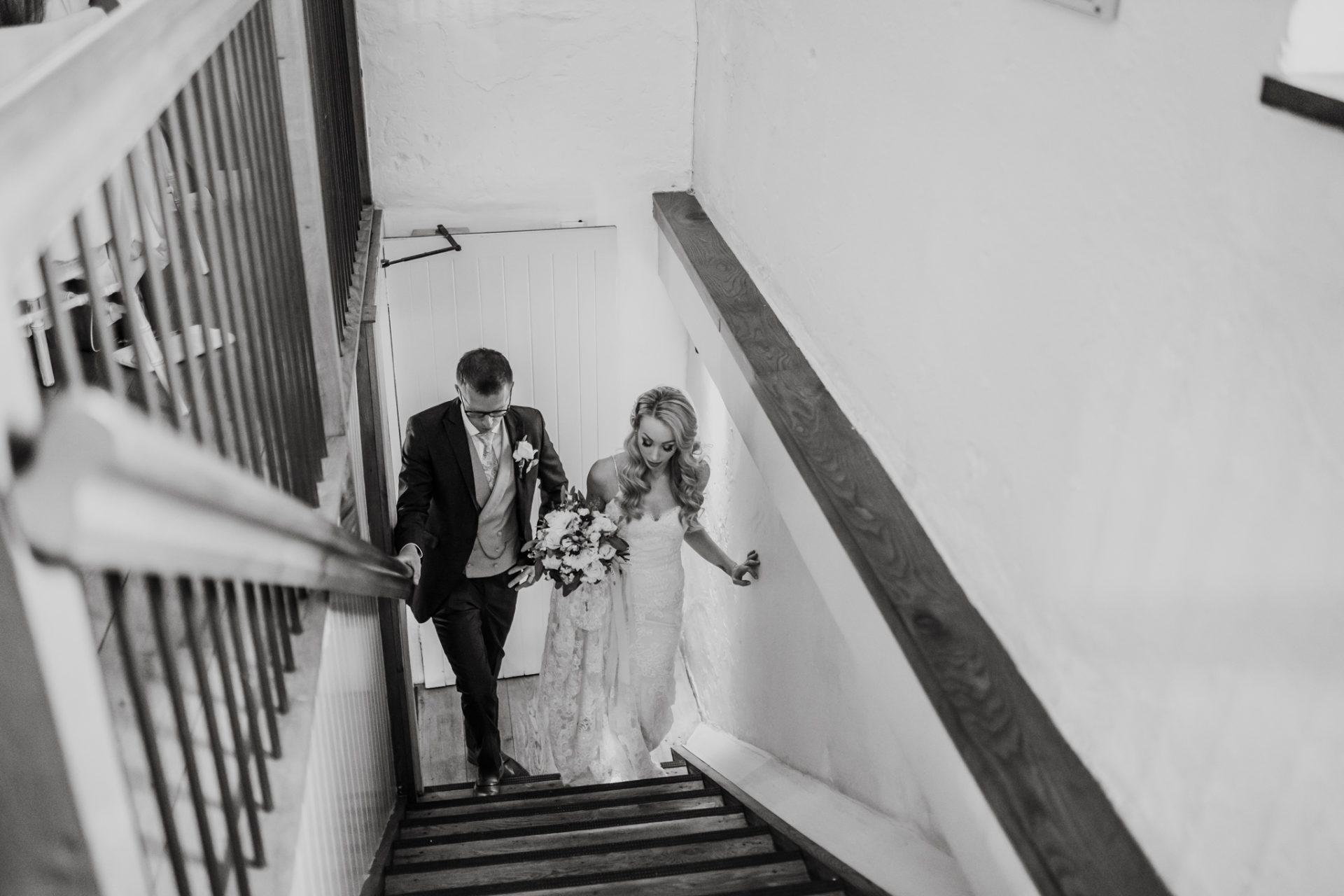 bride and groom wedding breakfast entrance priston mill
