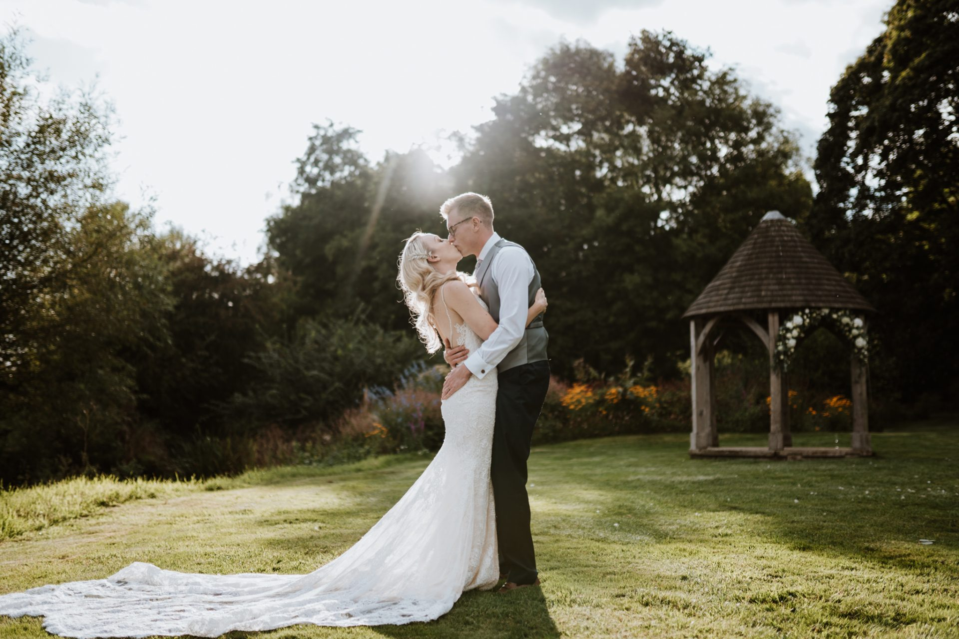 bride and groom kissing priston mill golden hour