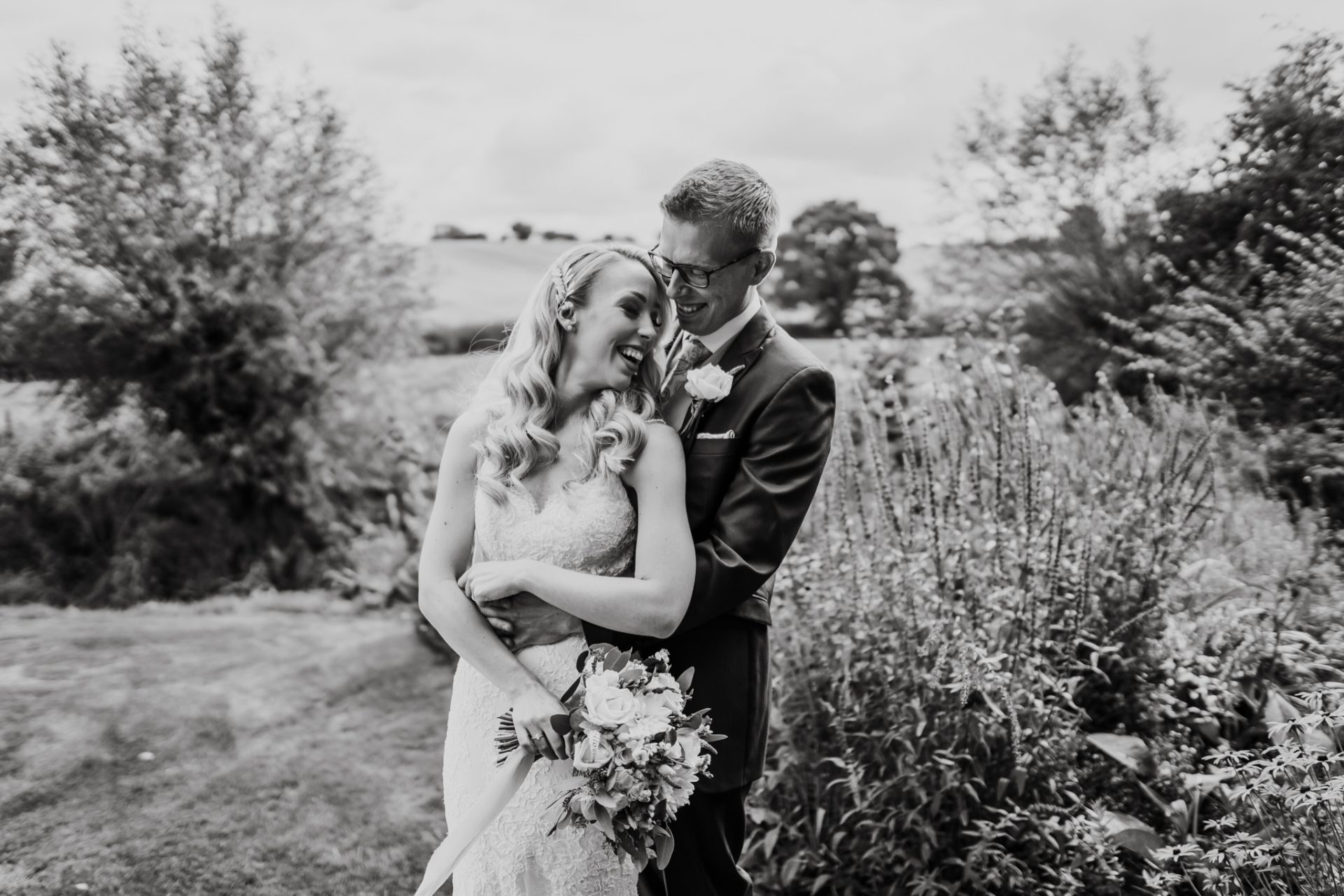 bride and groom laughing priston mill