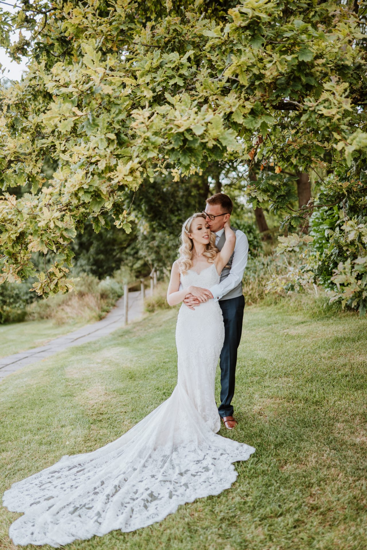 bride and groom under tree priston mill