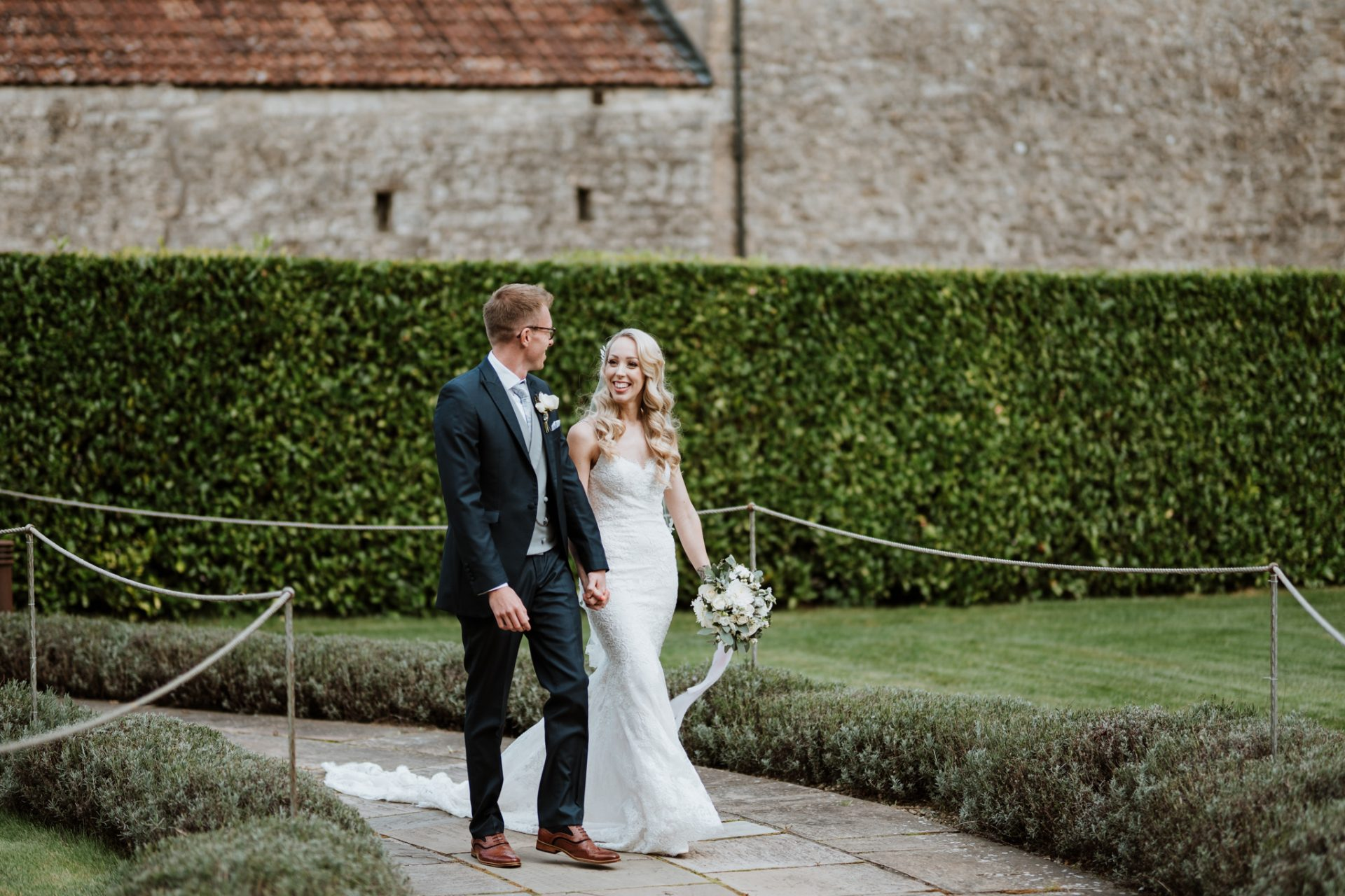 bride and groom walking priston mill