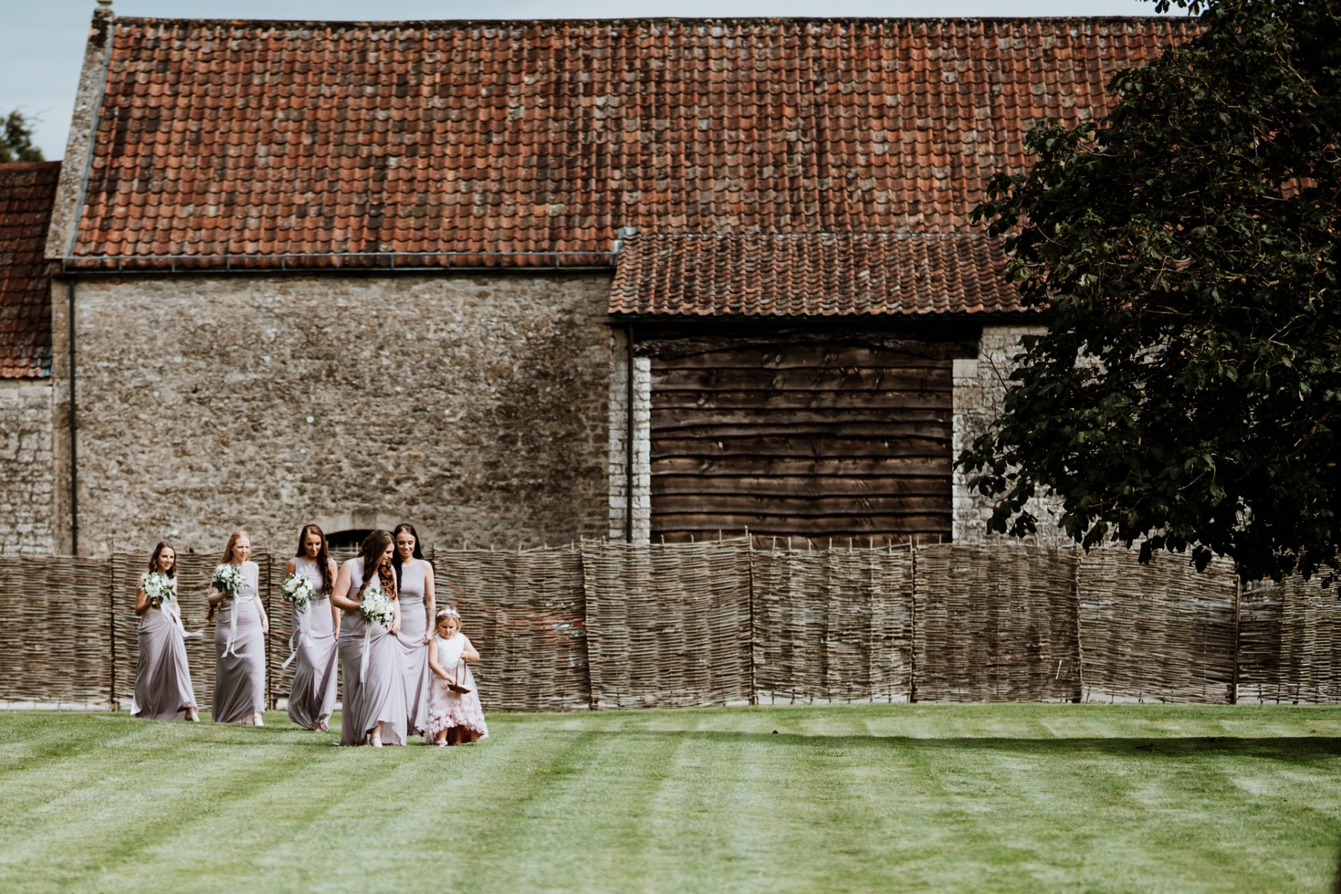 bridesmaids walking across the lawn outdoor ceremony