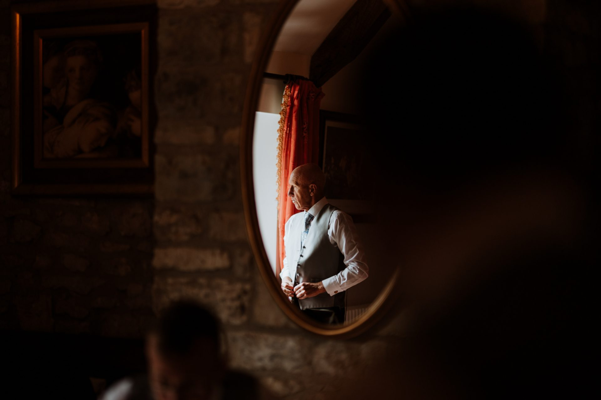 dad getting ready reflected in mirror