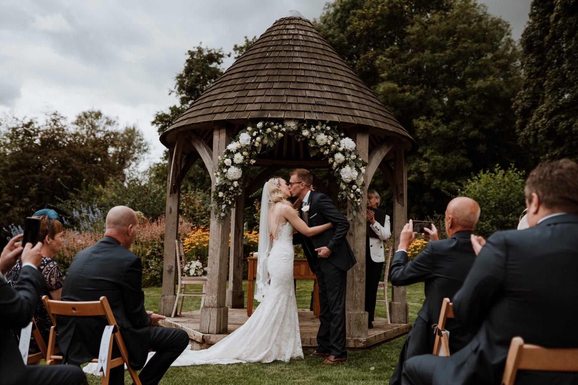bride groom first kiss gazebo priston mill