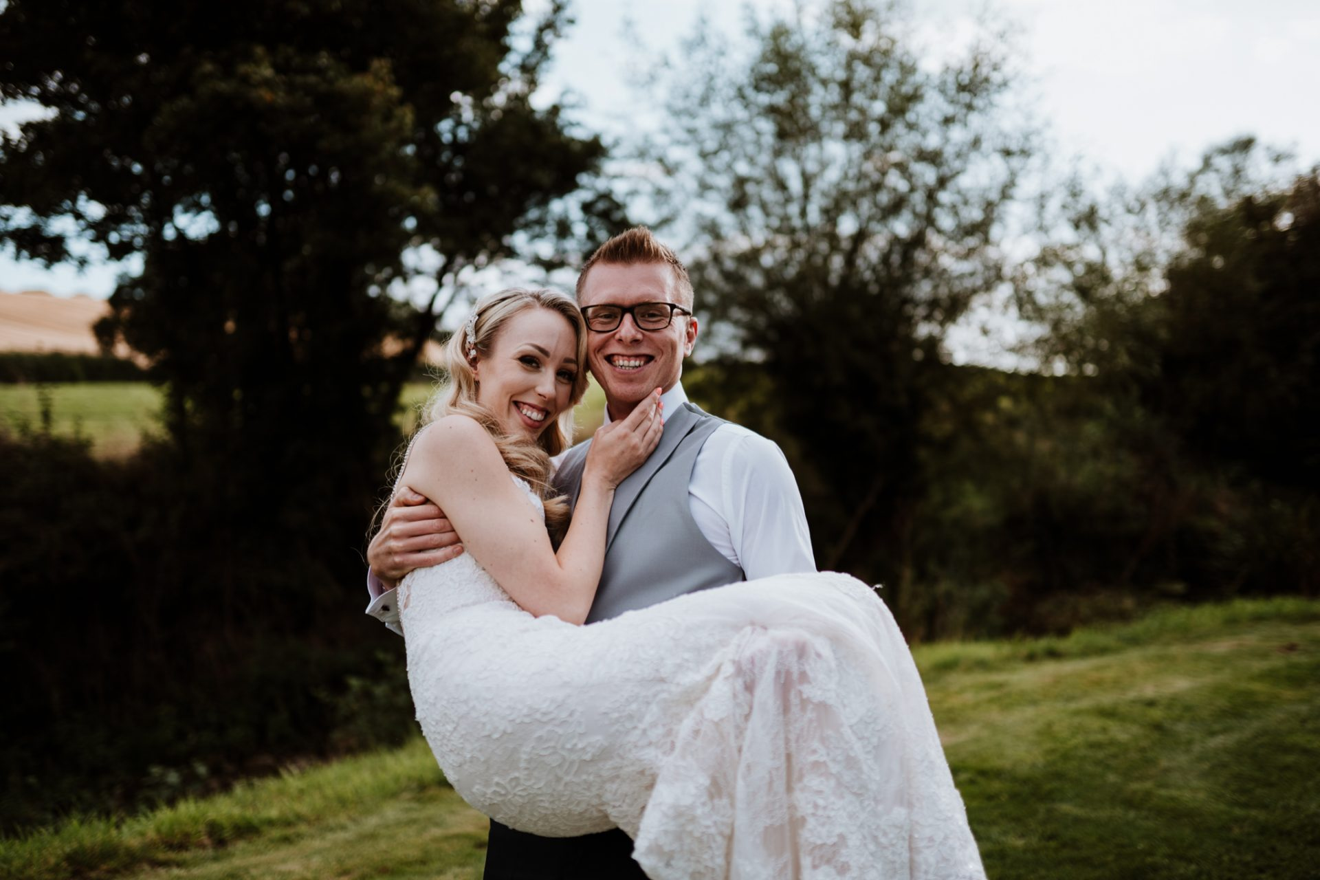 bride and groom laughing priston mill garden golden hour
