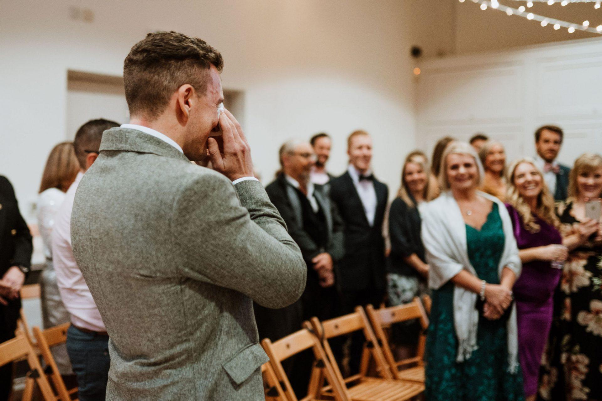 emotional groom during ceremony