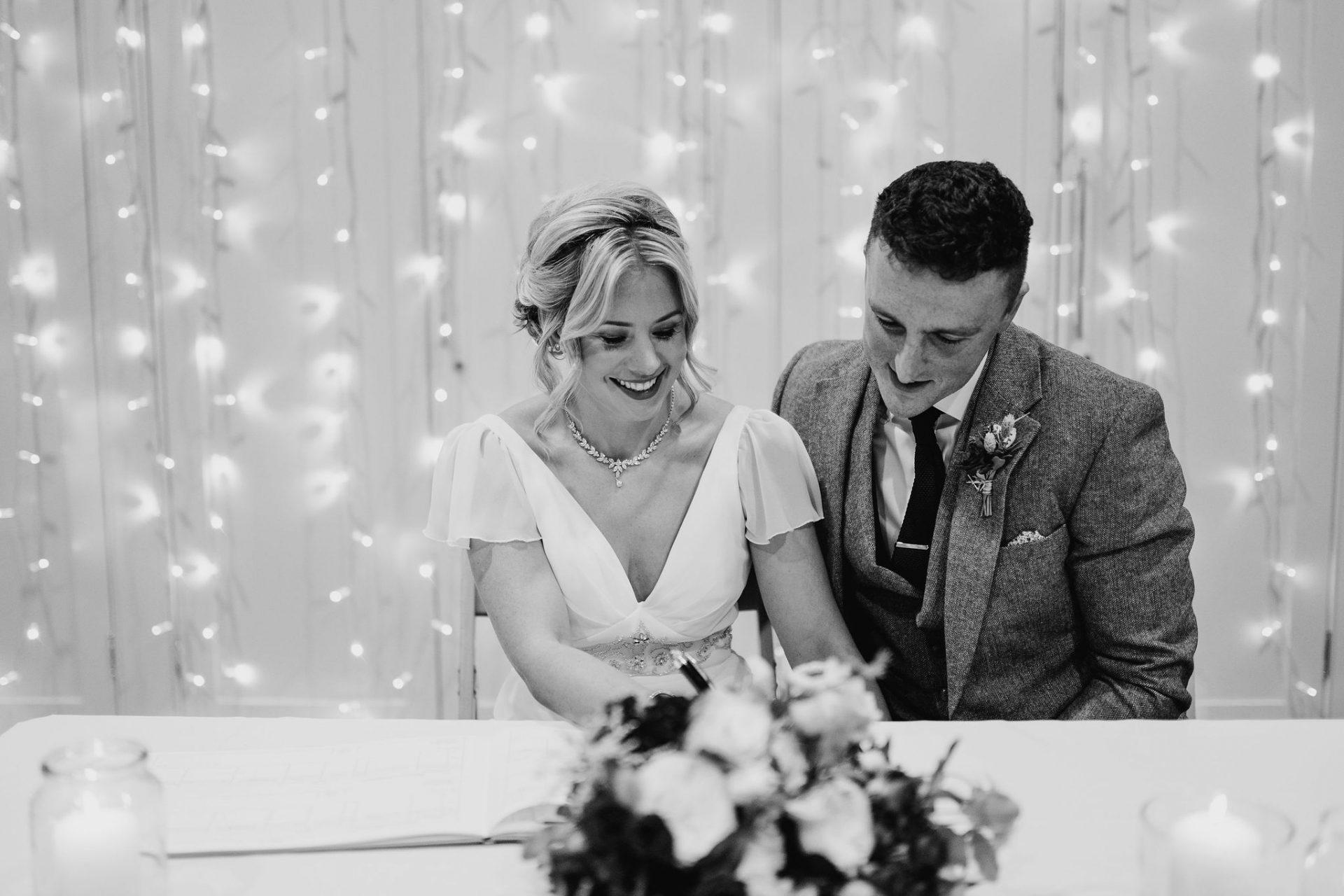 bride and groom signing register arnos vale