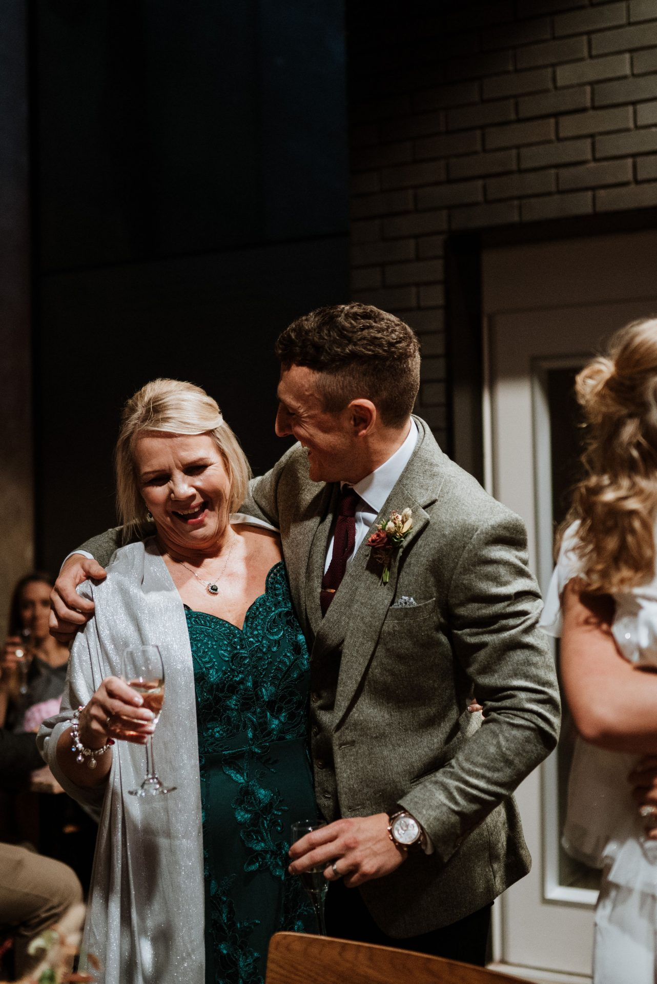 groom and mother of the bride laughing