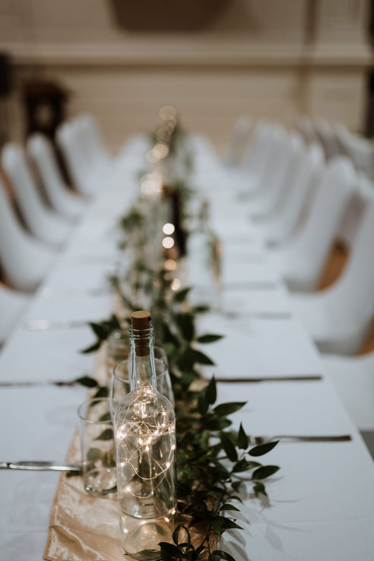wedding table decorations anglican chapel arnos vale fairy lights greenery