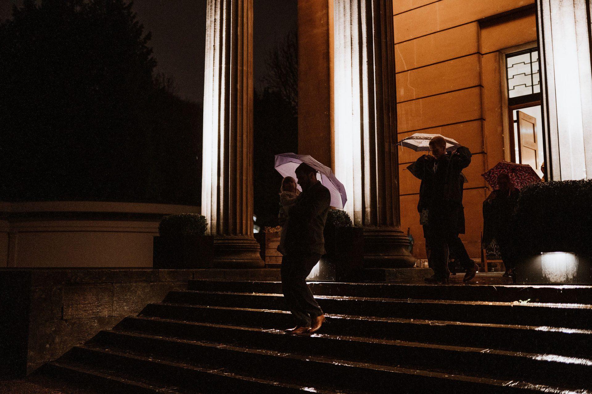 wedding guests umbrella night arnos vale