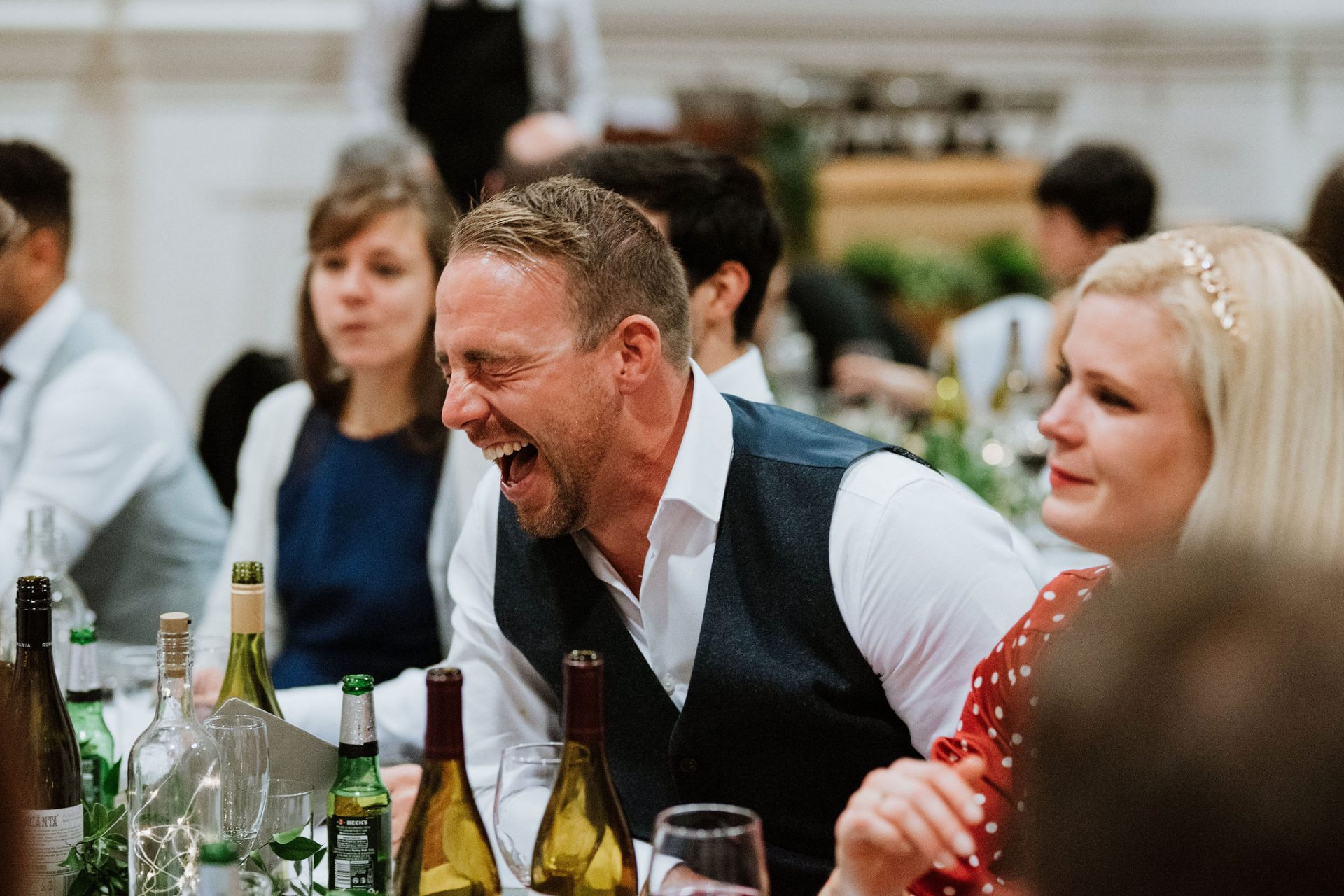 guests laughing wedding breakfast canid anglican chapel