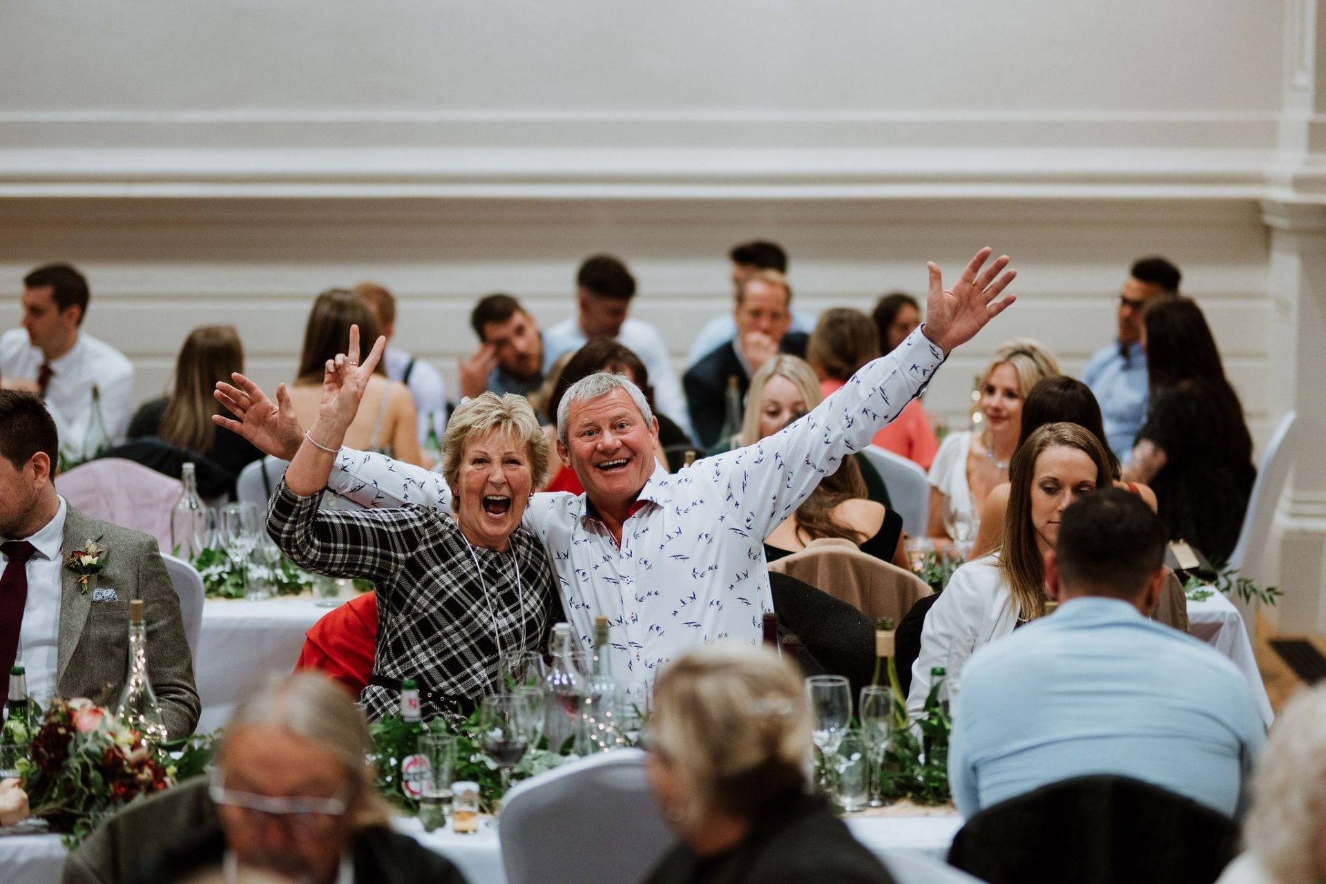 guests laughing wedding breakfast anglican chapel